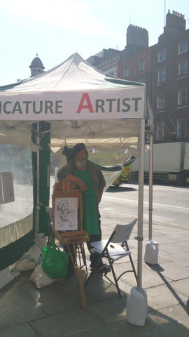 Dan at work at 'Yourface Gazebo' on the corner of Dame Street and Fownes street in Dublin 2 from 10am to 6pm Thursdays through Sundays -weather permitting. - Green Gallery