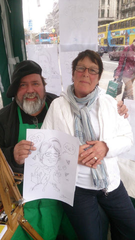 La is delighted with her caricature by Dan Young - Green Gallery