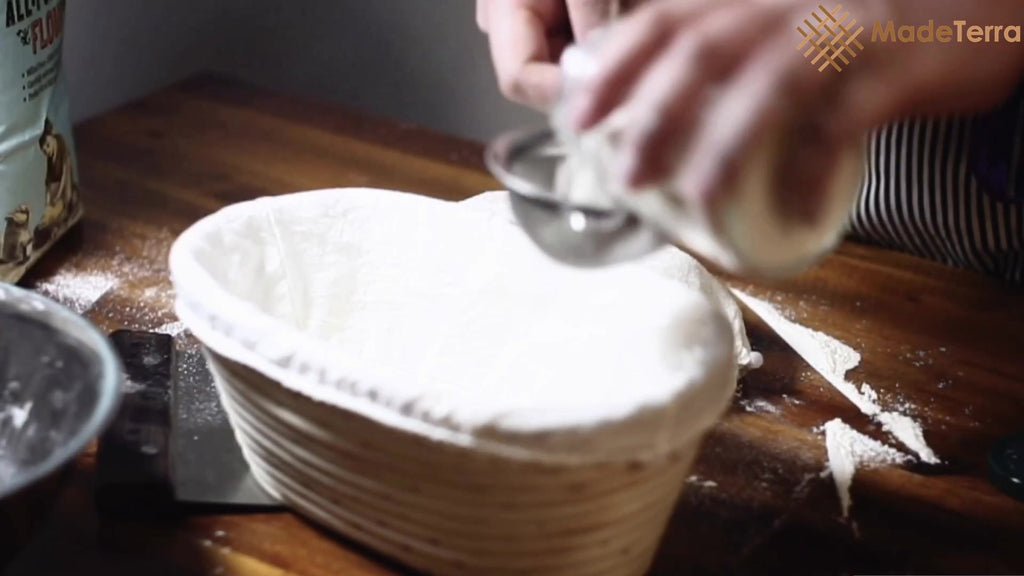 dust banneton proofing basket with flour before putting high hyration dough in