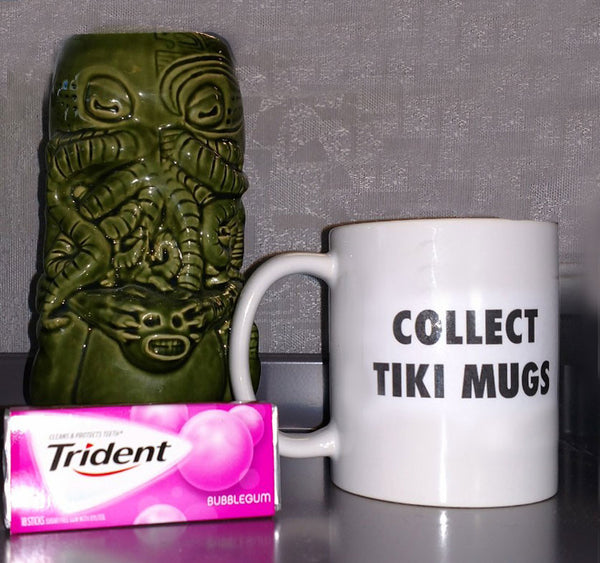 "$27.13 - April Fools' Mystery box + 1 ""COLLECT TIKI"" mug + Bubblegum"