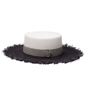 Two-coloured marina-inspired sun hat with frayed edge is meticulously made by hand using heritage hat making techniques, and carefully trimmed by Jolie Su in her studio.