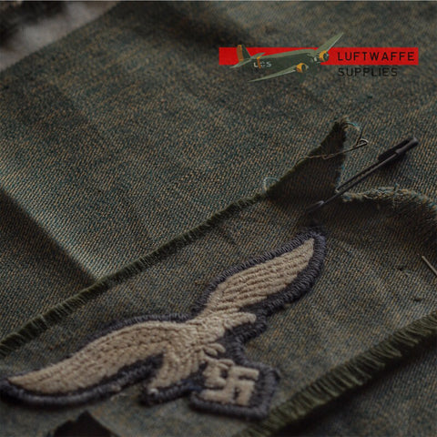 Luftwaffe Supplies grünmeliert fabric next to original fabric.