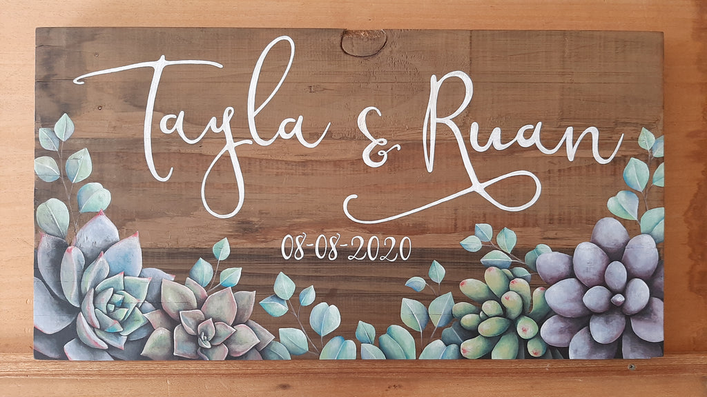 Can't lock down love: Hand-painted succulent wedding name board