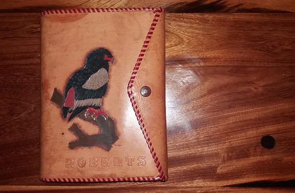 Leather bound Roberts bird book with bateleur eagle on cover