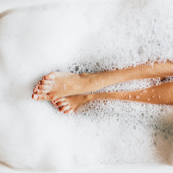 U Beauty Blog | How to Create an At-Home Spa | image of woman's legs in a bubble bath