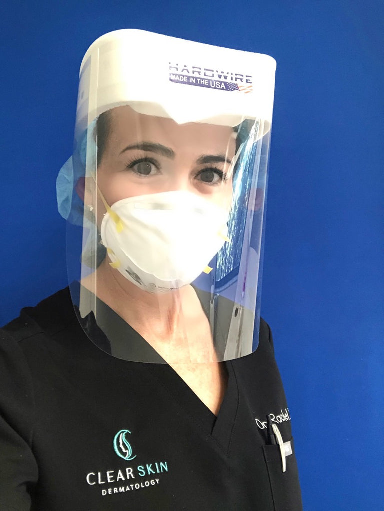 Dermatologist woman taking a selfie wearing a Hardwire Face Shield.