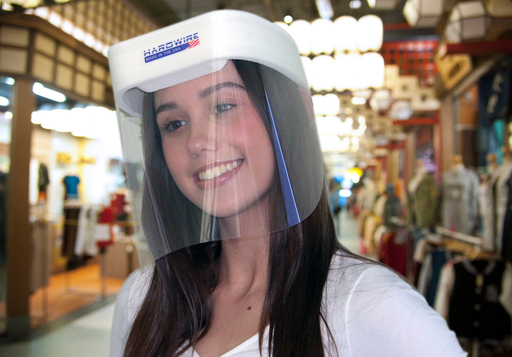 Woman shopping wearing a Hardwire Face Shield for protection.
