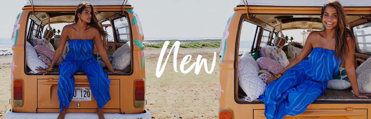 Model is wearing Rocky Jumpsuit. She is sitting in the trunk of an old organge VW Bus at the beach
