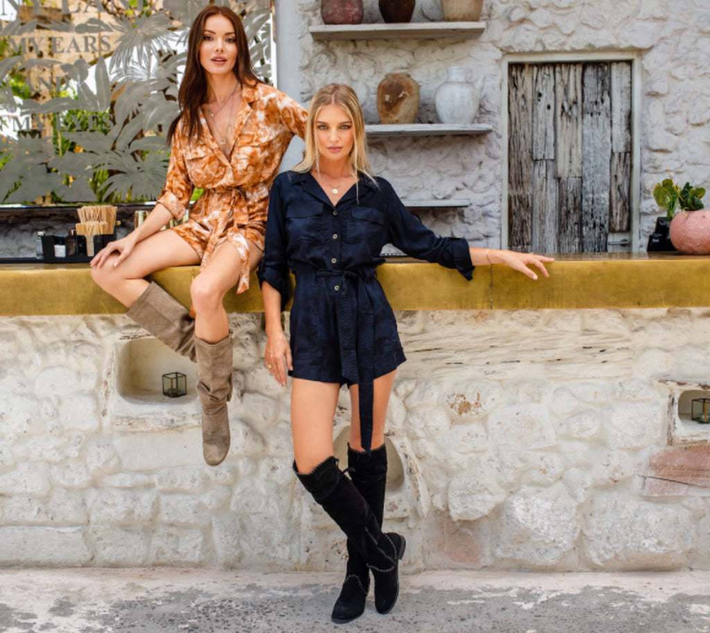 Models wearing mini dress and boots