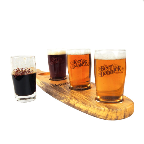 Beer Dabbler Tasting Glass alongside tasting paddle