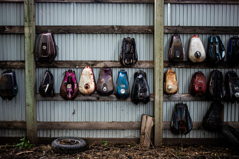 Gas Tanks on Wall at Motorcycle Graveyard • Tj Turner