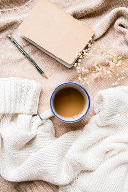 tografy, photographer business coaching, rest and relaxation, coffee, white sweater, journal and pencil, business coaching for photographers