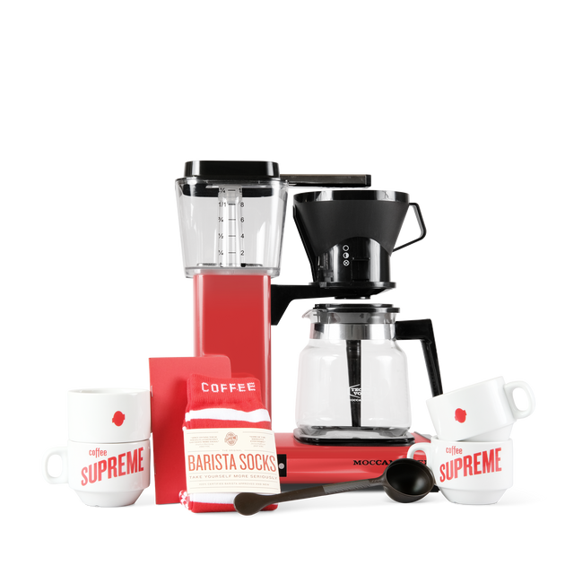 Moccamaster gift pack starter bundle. Comes with Moccamaster glass carafe, coffee measuring spoon, 4 stacker mugs, a pair of socks, and a brew guide.