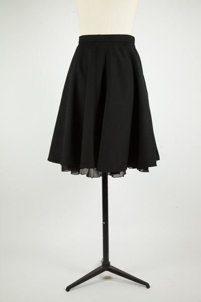 Black wool gabardine circle skirt with black organic cotton voile peek-a-boo lining.