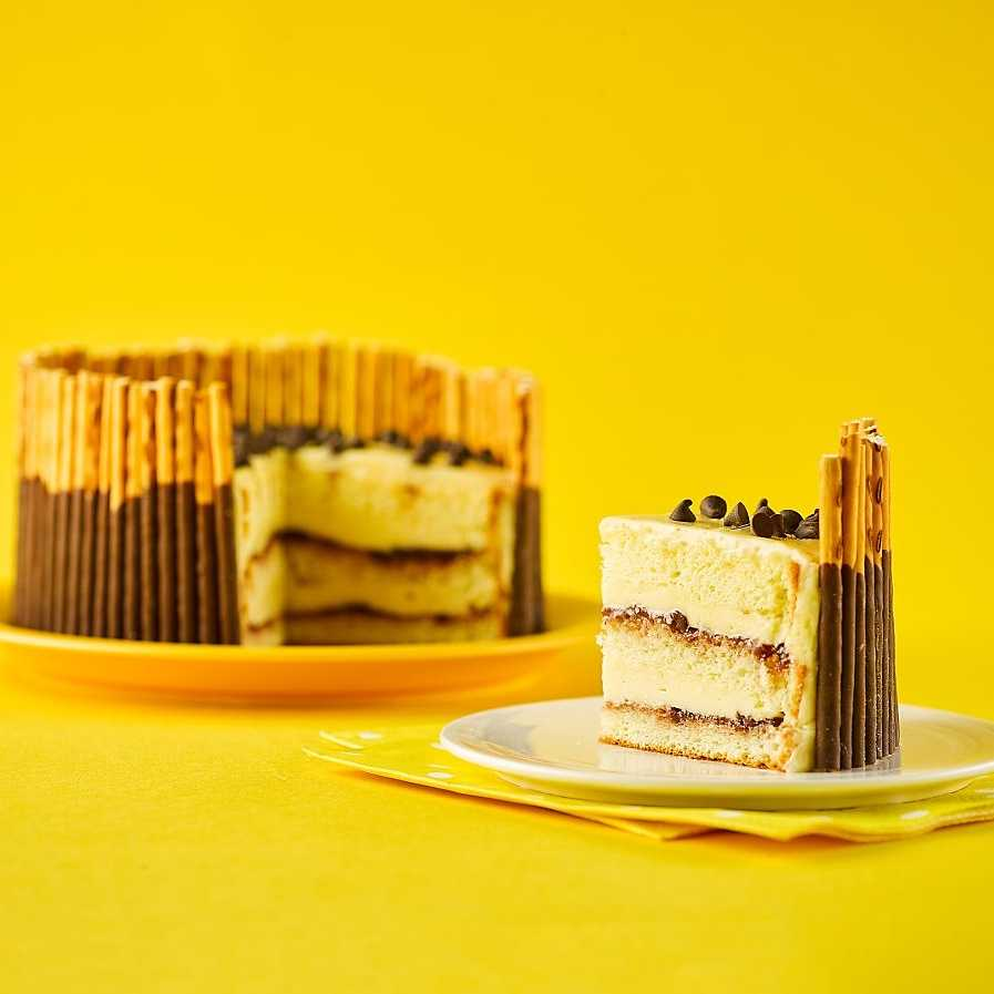 Korean Pocky Pepero cake in yellow background