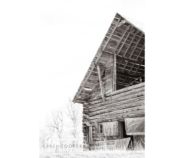 A black and white detail of an old barn, looking up.