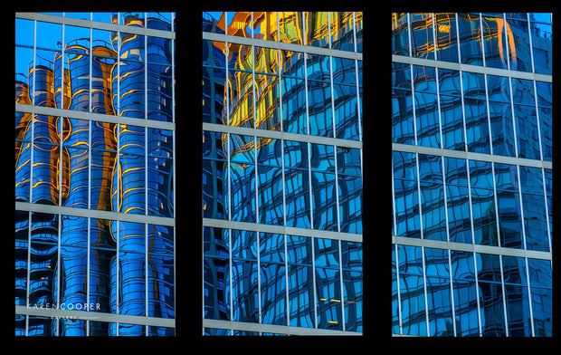 blue orange and yellow building reflection in glass the jameson house