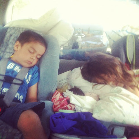 Sleeping on our way camping.