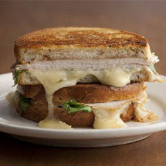Grilled turkey brie and apple butter sandwich with arugula