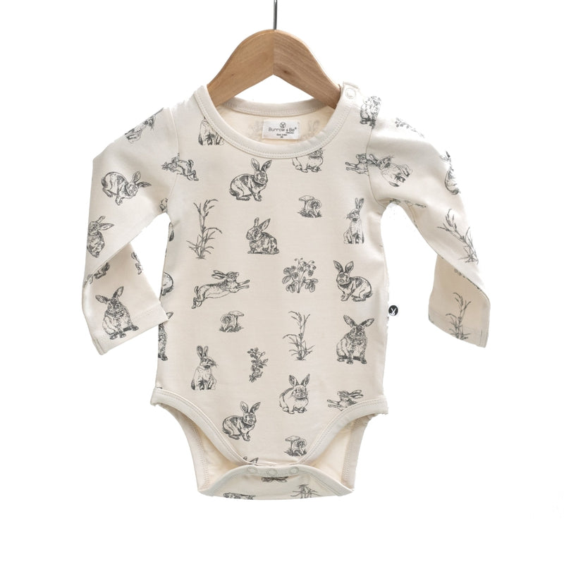 burrow & be baby essentials l/s bodysuit in almond burrowers print