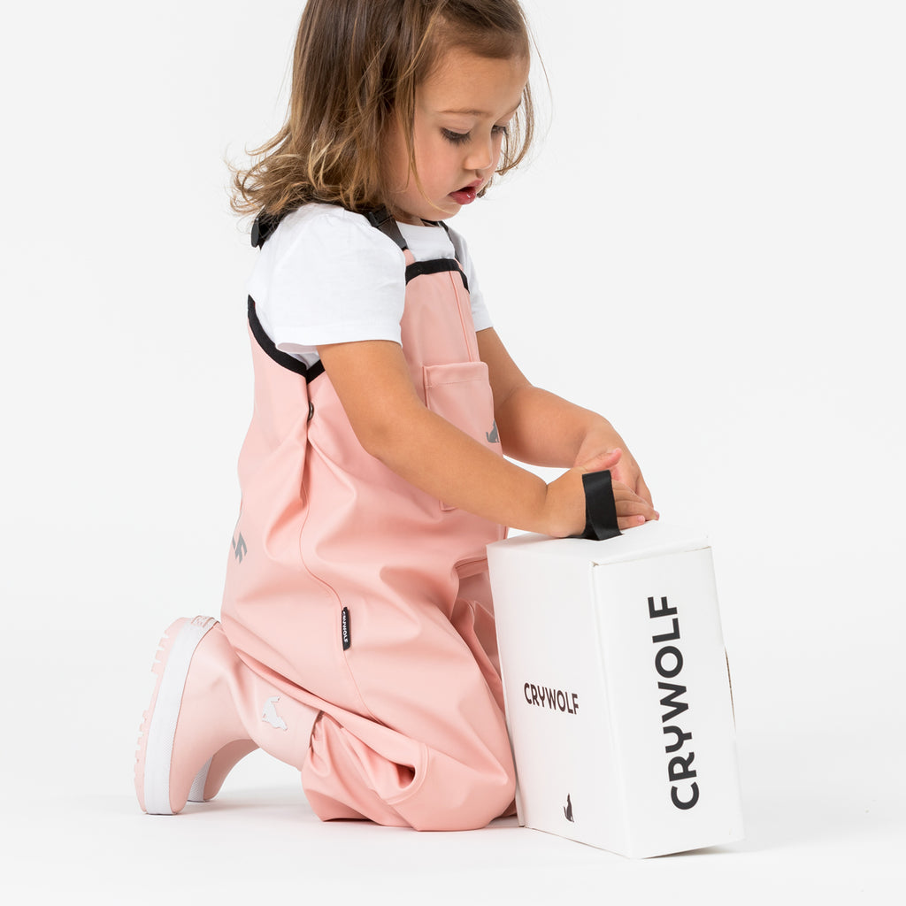 cry wolf rain overalls in blush pink