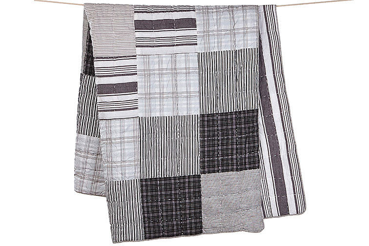 toshi cot quilt in patchwork charcoal
