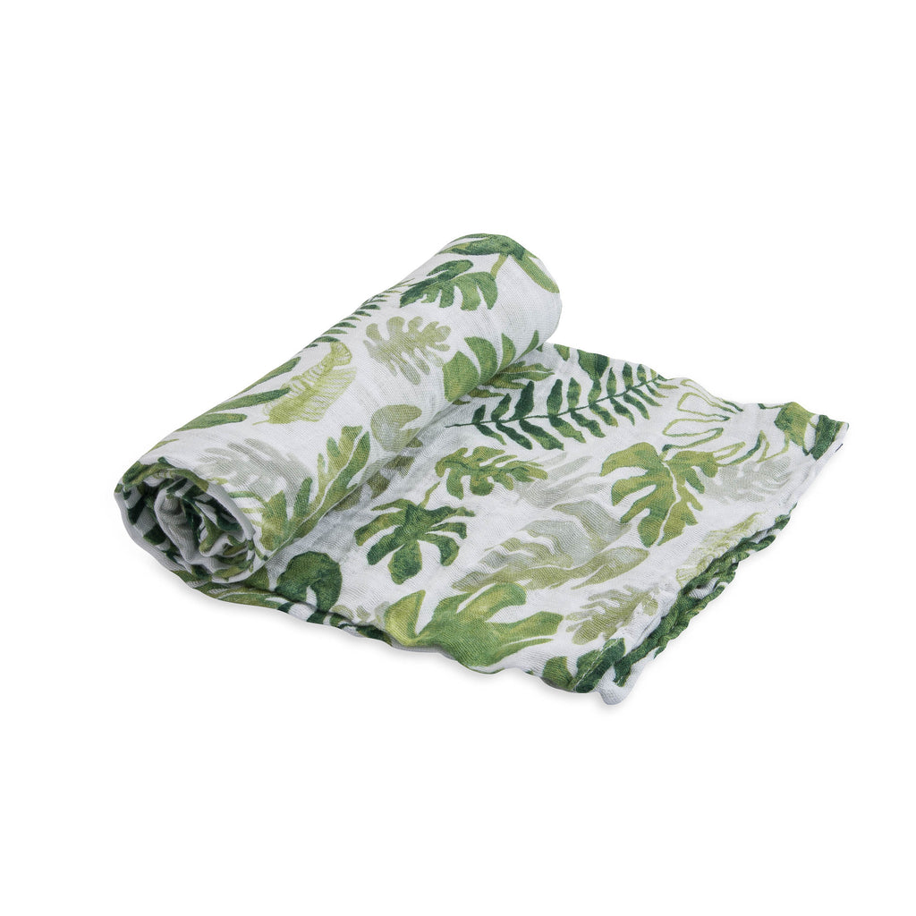 little unicorn cotton muslin swaddle in tropical leaf