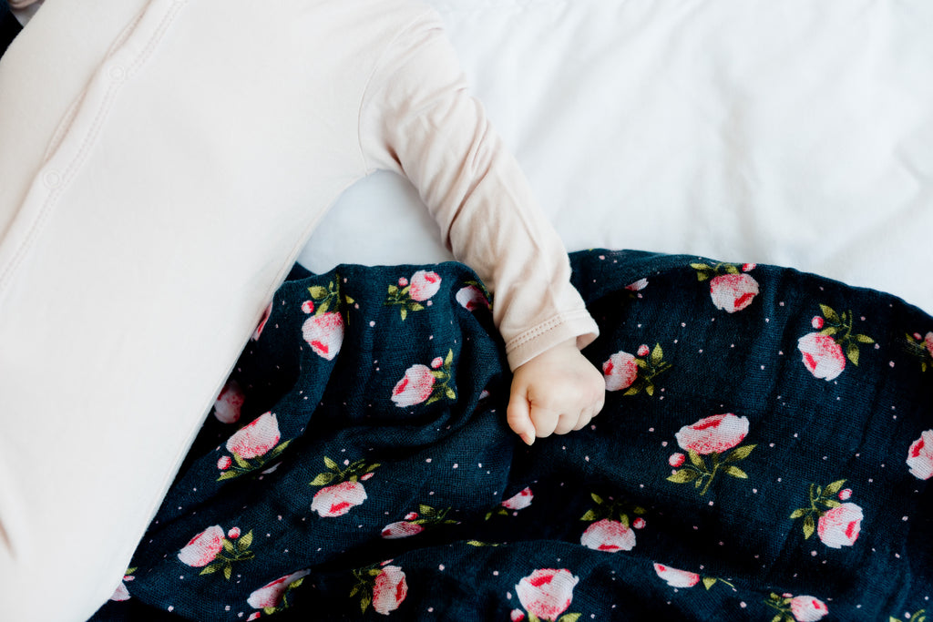 little unicorn cotton muslin swaddle in midnight rose