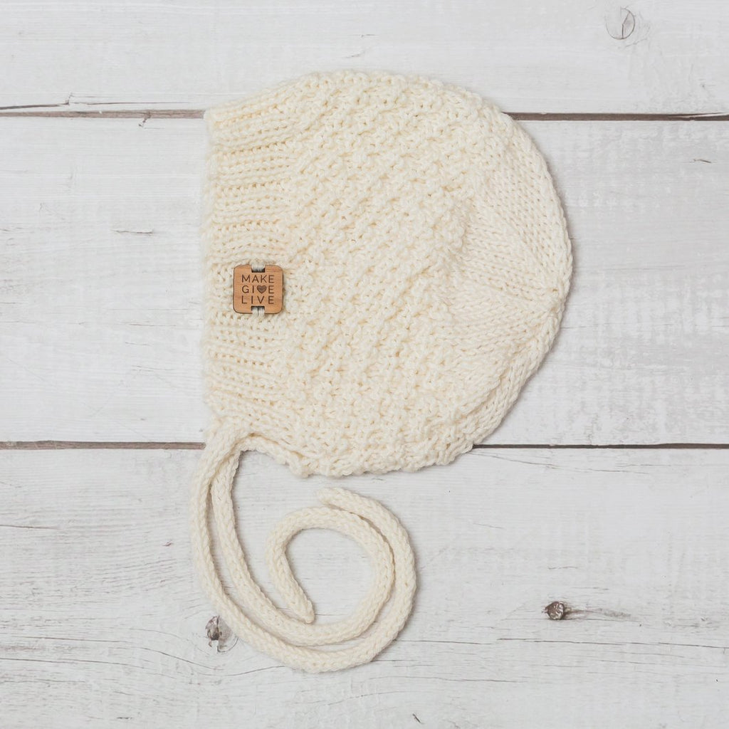 make give live baby merino bonnet in moon