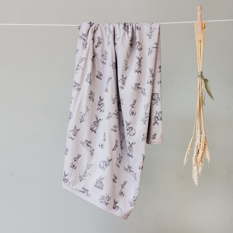 burrow & be baby swaddle in grey burrowers print