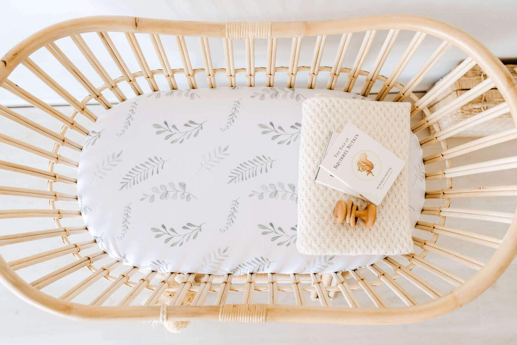 snuggle hunny kids bassinet sheet in wild fern print
