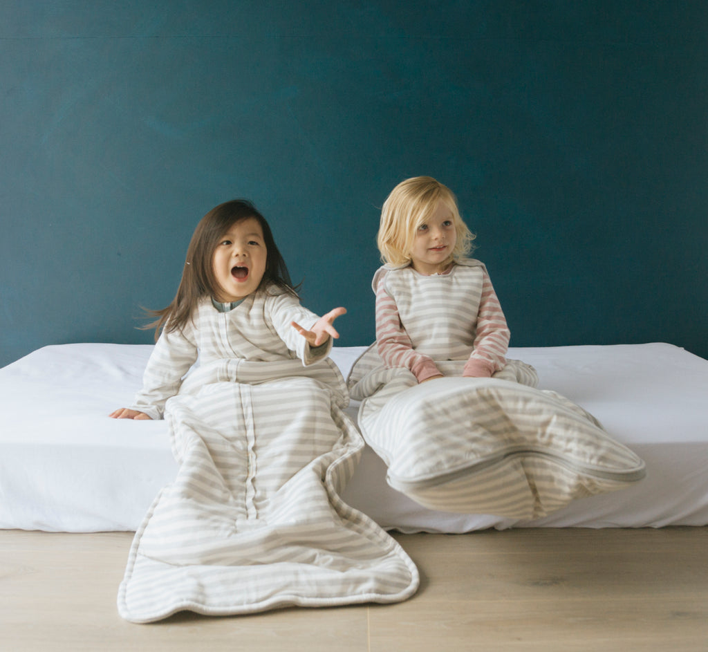 woolbabe duvet sleeping bag with arms in pebble stripe