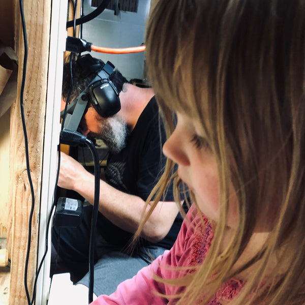 daughter helping in the workshop