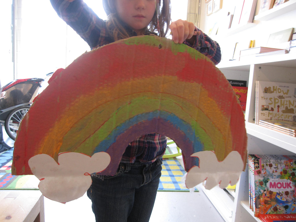 kids making a rainbow paper craft at collage collage