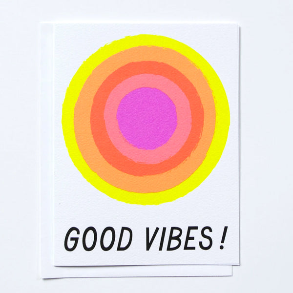 "Greeting card with neon glowing sun and the text ""Good Vibes"" underneath by Banquet Workshop"