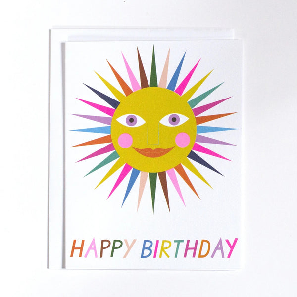 "Banquet Greeting Card with a Sunshine that has rainbow rays and ""happy birthday"" written in rainbow letters along the bottom on a white background"