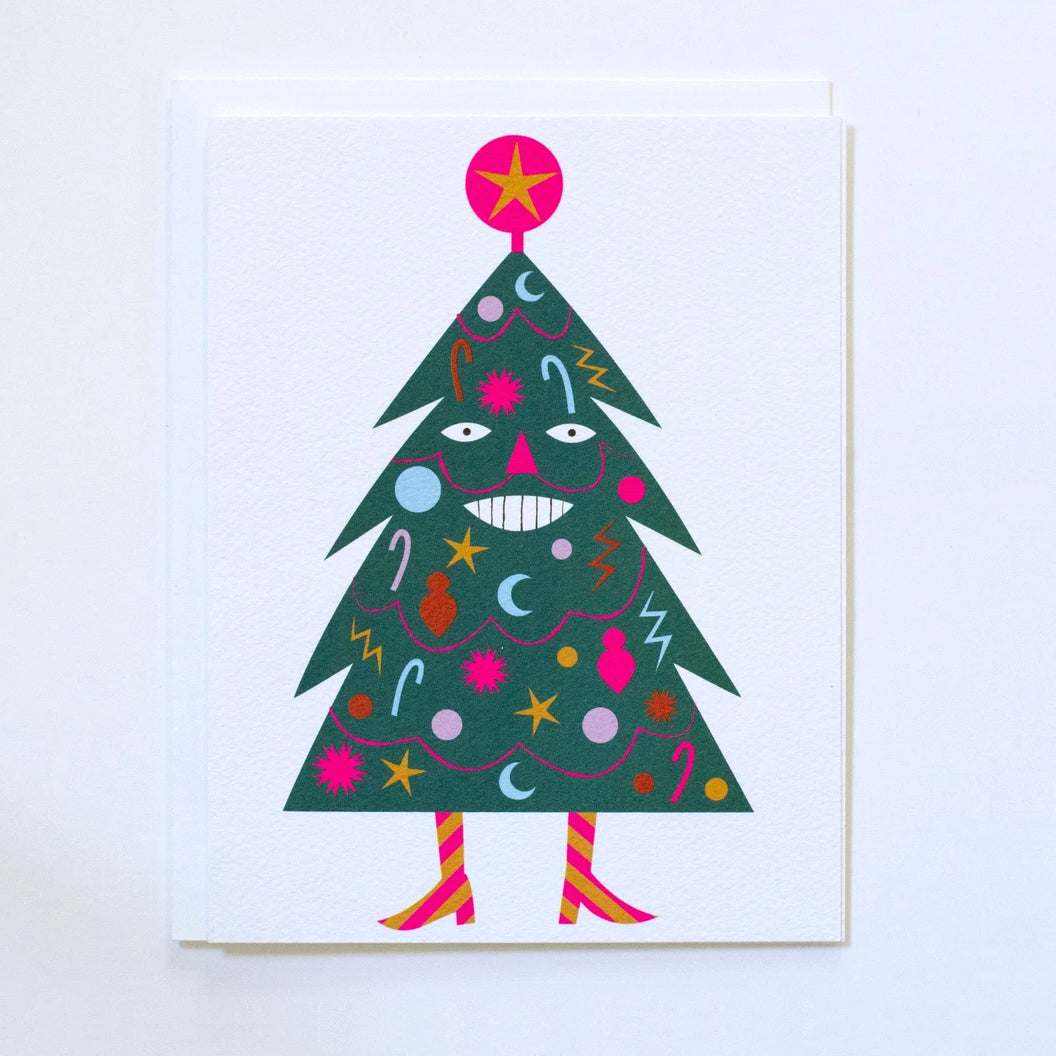 Greeting Card by Banquet showing a decorated green holiday tree with a smiling face, mustache, neon pink garlands and ornaments