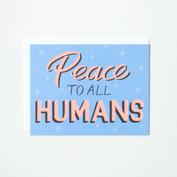 "Greeting card by Banquet with the text ""Peace to all Humans"" in light pink with a blue background in a vintage sign inspired hand lettering"