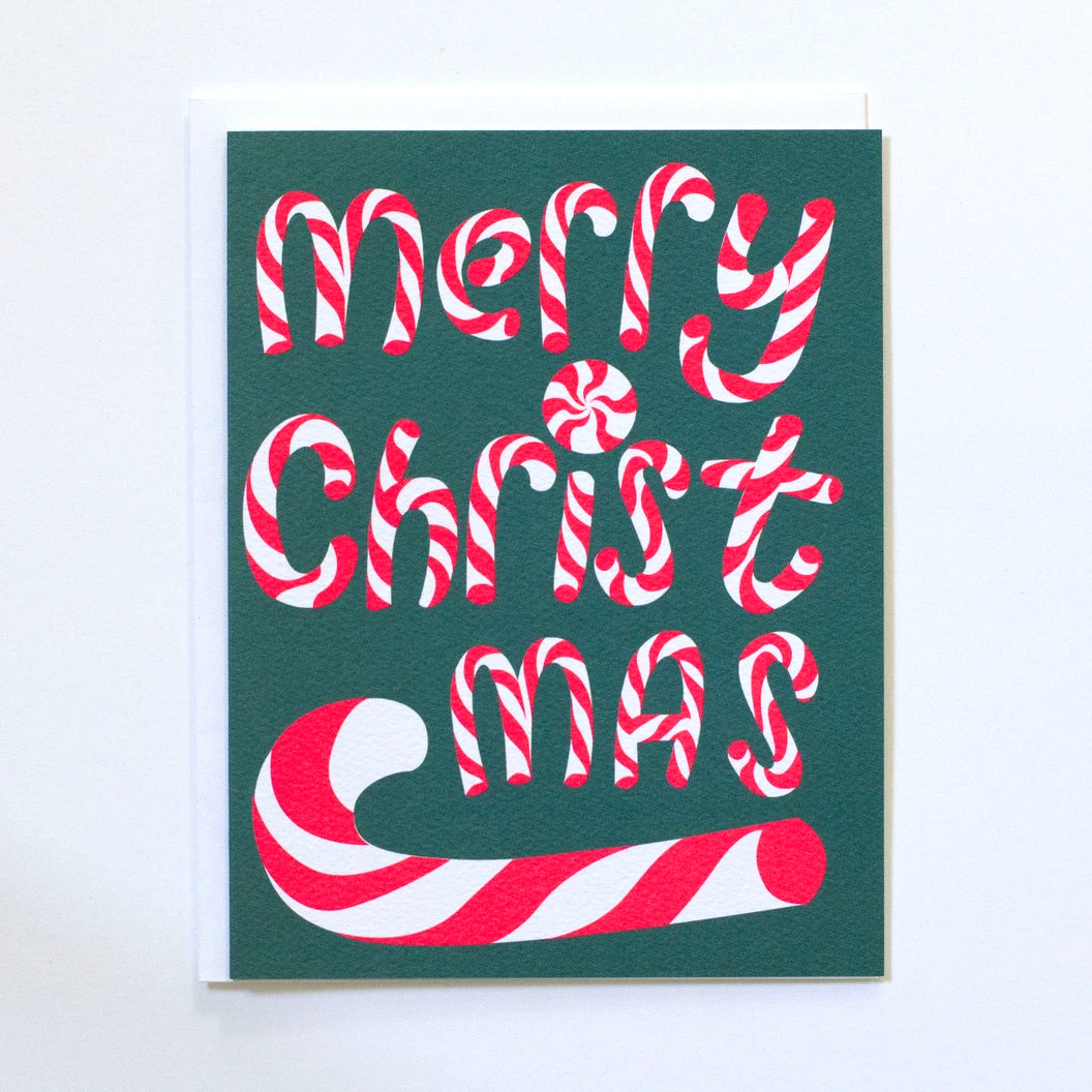 Greeting Card by Banquet with Merry Christmas spelt out in neon pink candy canes and a dark green background