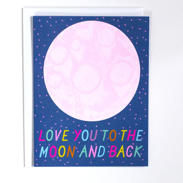 "Greeting Card with the words ""Love you to the moon and back"" in rainbow letters with a pink moon on a blue card by Banquet Workshop"
