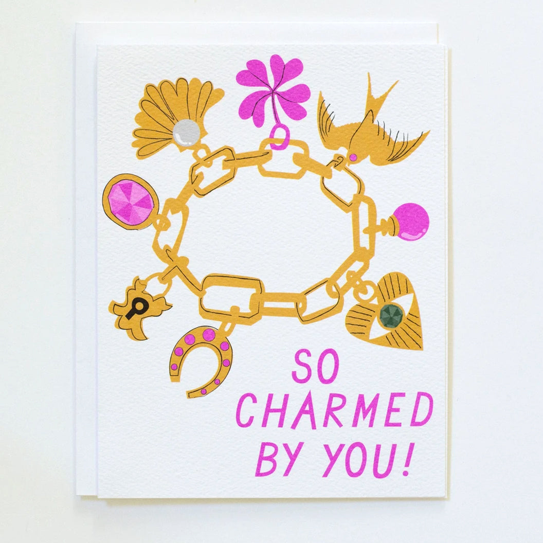 "Greeting Card with an image of a charm bracelet and the words ""So Charmed by you!"" in bright pink, by Banquet Workshop"