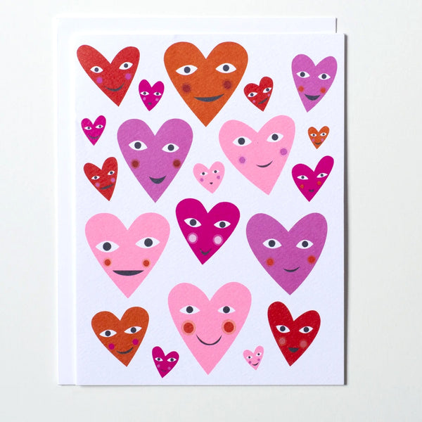 Love or Valentine Greeting card with many smiling heart illustrations in various shades of pink and red by Banquet Workshop