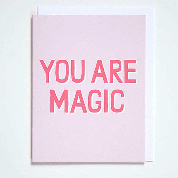 "Greeting card on blush pink with the words ""You are Magic"" in neon pink by Banquet Workshop"