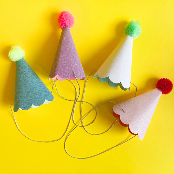 Set of 8 birthday party hats with pom poms by Meri Meri
