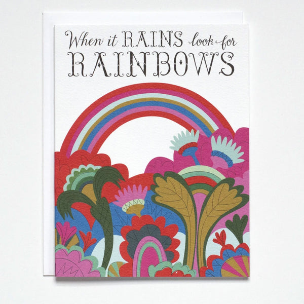 "Greeting Card with modern flowers and rainbow illustration and the text ""When it Rains look for Rainbows"" by Banquet"
