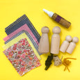 Peg Doll craft kit with farbic, glue, and string