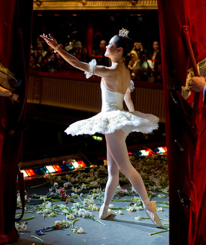Miyako Yoshida on a flower-strewn stage at the final curtain call of her last appearance at the Royal Opera House in April 2010 after dancing Cinderella in Sir Frederick Ashton's ballet