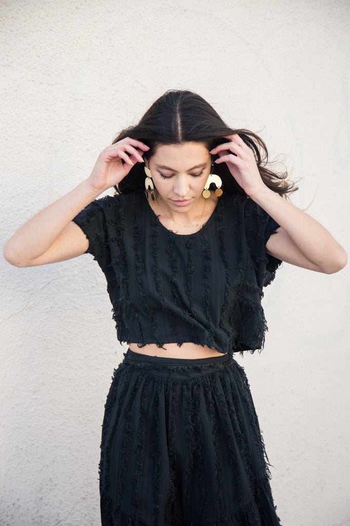 nico nico griffith sheer crop top in black and natural