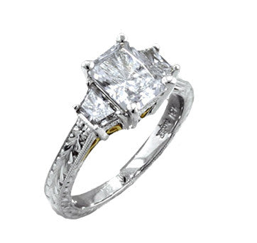 Platinum Radiant Cut Diamond With Tapered Baguette Side Stones In Engraved Mounting