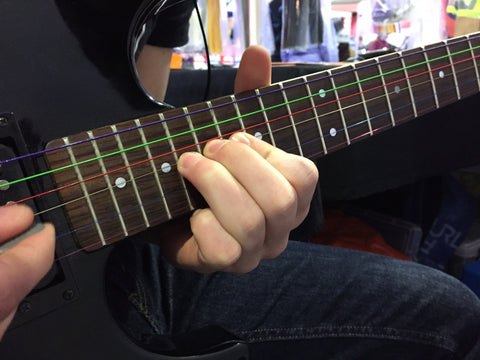 Multi Coloured Electric Guitar Strings matched to a black Yamaha ERG guitar